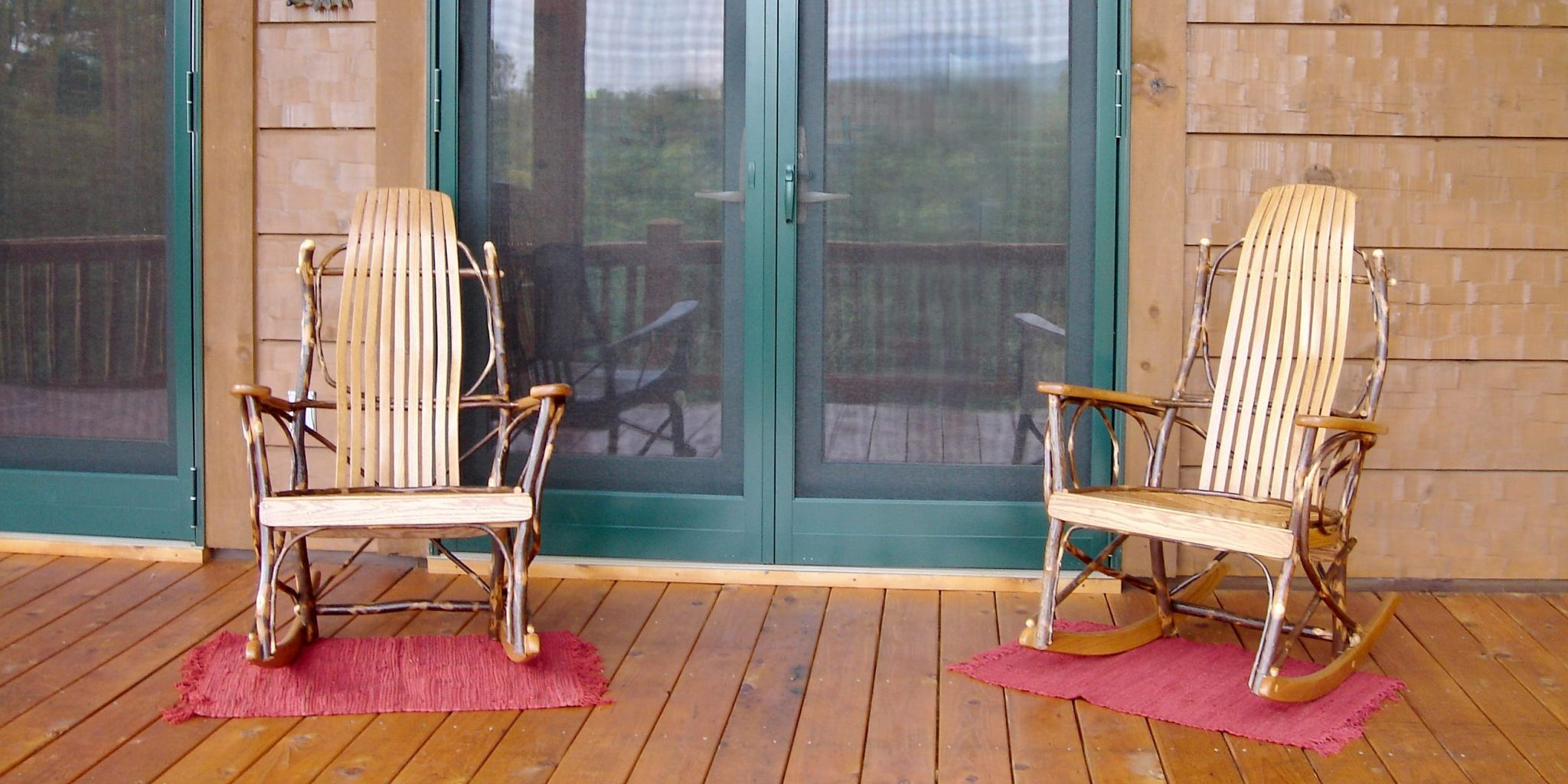Bent wood rocking chairs on deck of log home